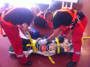 Our two clinicians preparing the patient for a stretcher winch
