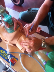Our crew practicing a surgical airway on a task trainer